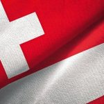 Switzerland_and_Austria_flags_together_relations_textile_cloth,_fabric_texture