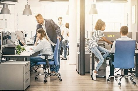 Team_at_work._Group_of_young_business_people_working_together_in_creative_modern_office.